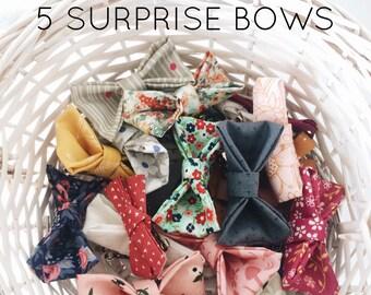 5 surprise bows!