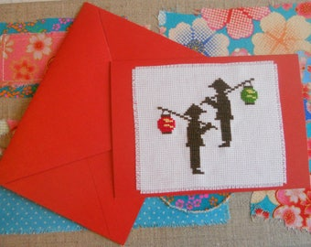 Embroidered card with characters from the Chinese new year