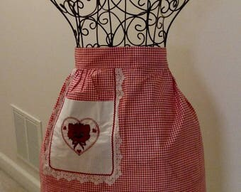 Pre-used worn fancy red and white gingham party apron with a red embroidered kitty  and lace trim
