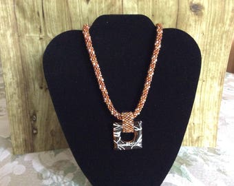 Beaded necklace with glass focal