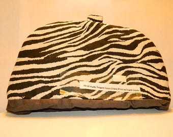 Zebra tea cozy with black on the inside
