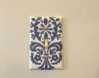 Fabric covered toggle switchplate