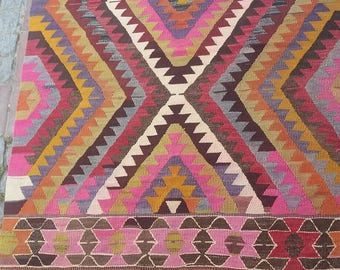 Turkish kilim rug. Bright, vibrant colours. Geometric pattern. Over 40 years old. Made in Antalya. Hand woven kilim. Vintage style.