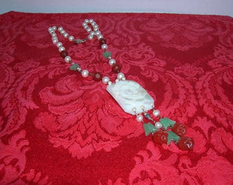 A Vintage necklace made with red and white beads