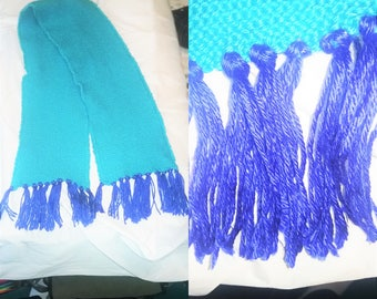 Shiny blue scarf with tassels.