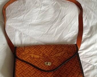 Light brown leather vintage bespoke bag.