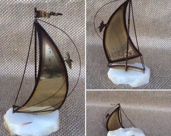 Brass sailboaton marble base