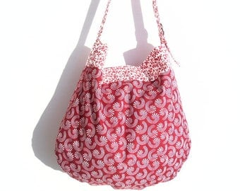 Printed graphic and floral fabric summer shoulder bag.