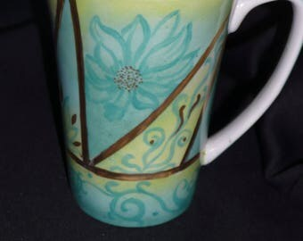 Mug in the colors of the East (turquoise, lime and gold) hand painted porcelain.