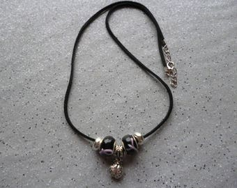 Rope necklace with round beads and a ladybug charm