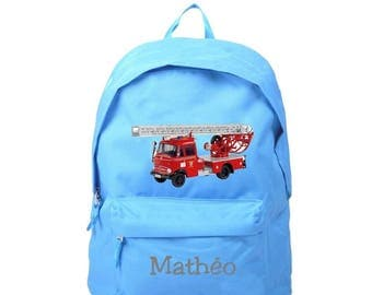 bag has blue fire truck personalized with name