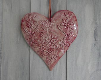 Ceramic flowers in relief red hanging heart