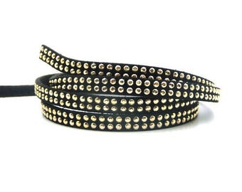 1 meter of Black Suede with double rows of 5mm Golden rivets