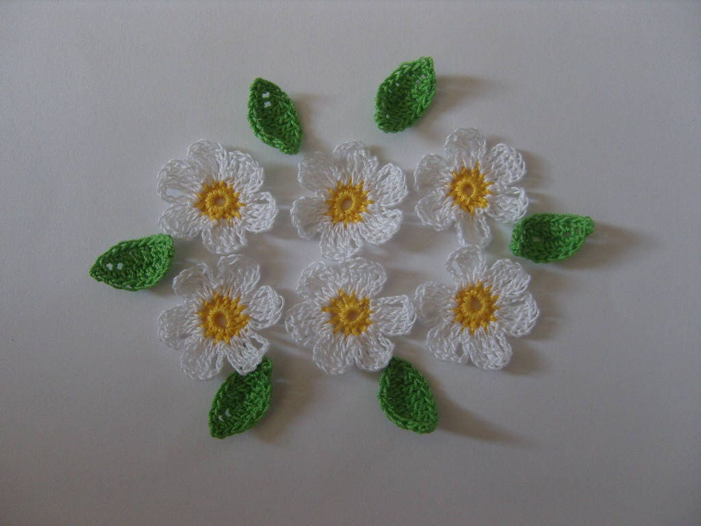 Crocheted in cotton yellow and white flowers applique from