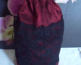 dark red fabric and lace pouch