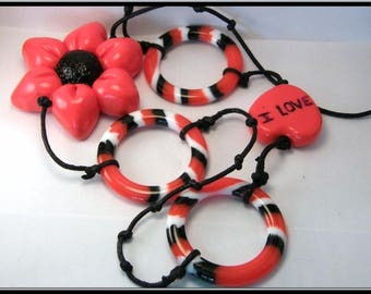 Polymer clay and acrylic spacer Red/Black/White Flower necklace.