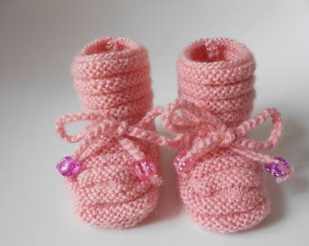 pale pink boot style slippers with cord