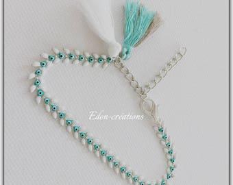 Turquoise and white spike bracelet, tassel