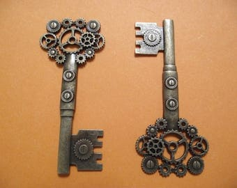 1 large steampunk antique bronze key charm.