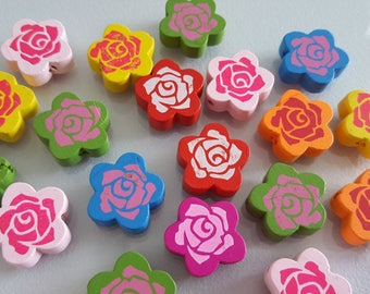 12 wooden 2 x 0.6 cm flower pattern beads