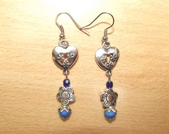 Blue earrings with charms.