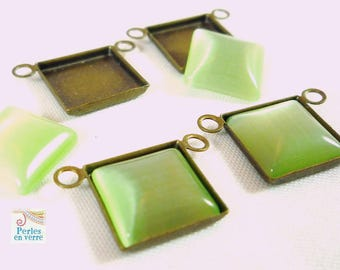 2 bronze charms with 2 10mm, (bre195) Apple green cat's eye cabochons