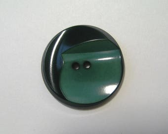 Round antique button, 26 mm, 2 shades of green, 2 holes.