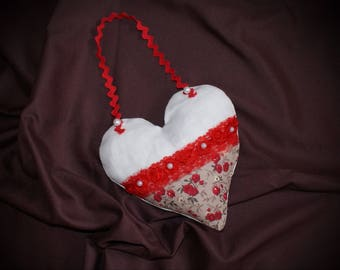 heart in red and white fabric