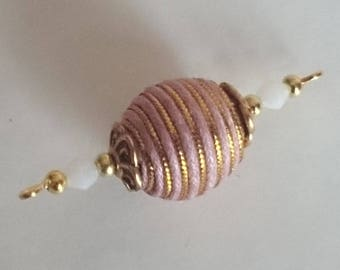 A connector with a large fabric bead and glass beads