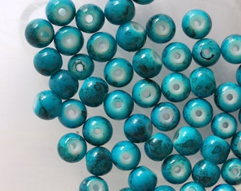 Lot 5 round blue glass beads