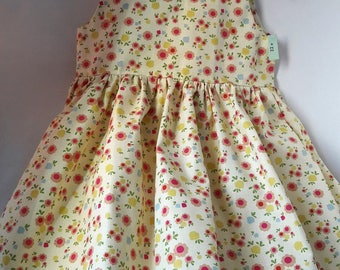 dress has yellow and raspberry nouilletttes