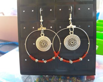 Steel hoops, red beads and charm