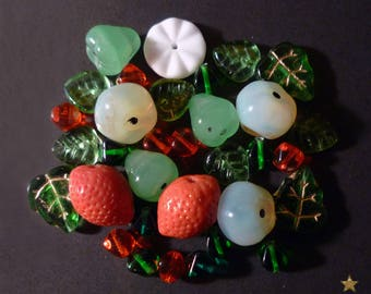 32 mixed green, orange, white Czech glass beads.