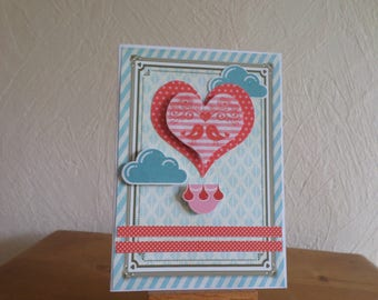 card with heart and two birds which look...