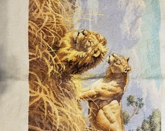 Completed cross stitch of lions