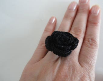 ring with a black colored crochet rose