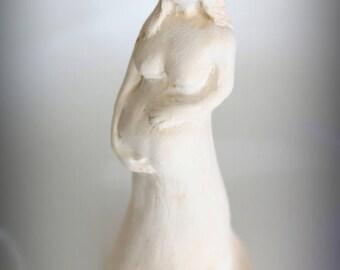 pregnant woman plaster statuette