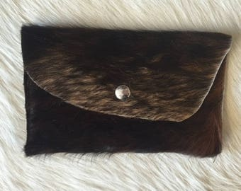 Brown Hair on Hide Pouch