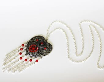 Necklace with heart pendant and coral beads