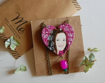 With the heart-shaped necklace with hand painted portrait