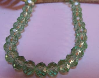 Set of 70 green faceted beads