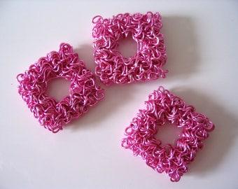Dark pink metallic bead