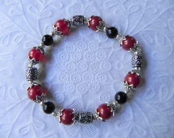 Red jade gemstone and black agate stretch bracelet