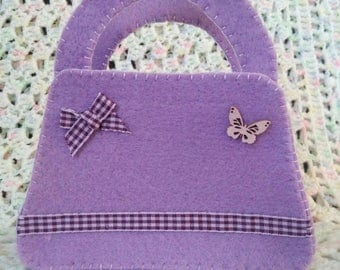 Small purple and plum felt bag.