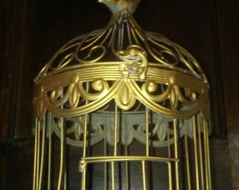 1920's vintage iron welded gold painted birdcage with bird on top