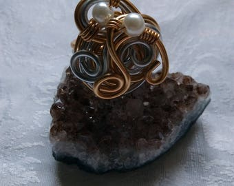 ring in aluminum wire and glass beads
