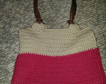 crocheted tan and burgundy lined handbag with dark brown straps