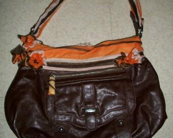 Brown repaints fabric orange and Brown