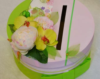 Pink and green envelopes round urn