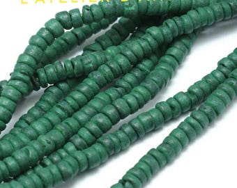 Strand 39 cm abacus shaped beads, approximately 130 beads in dark green tinted coconut